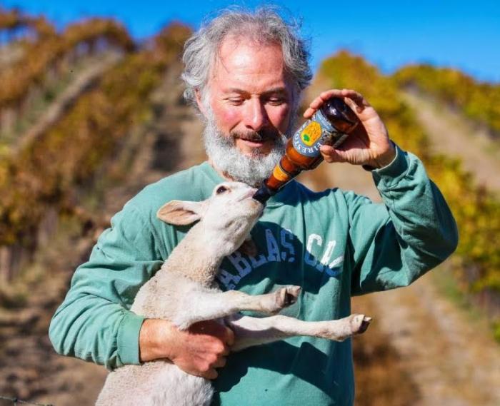 Gustavo feeding lamb