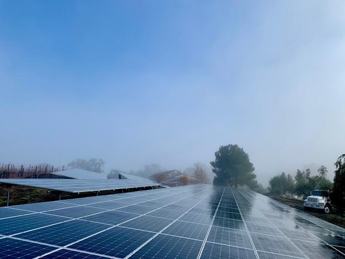 Solar panels vineyard truck and blue sky
