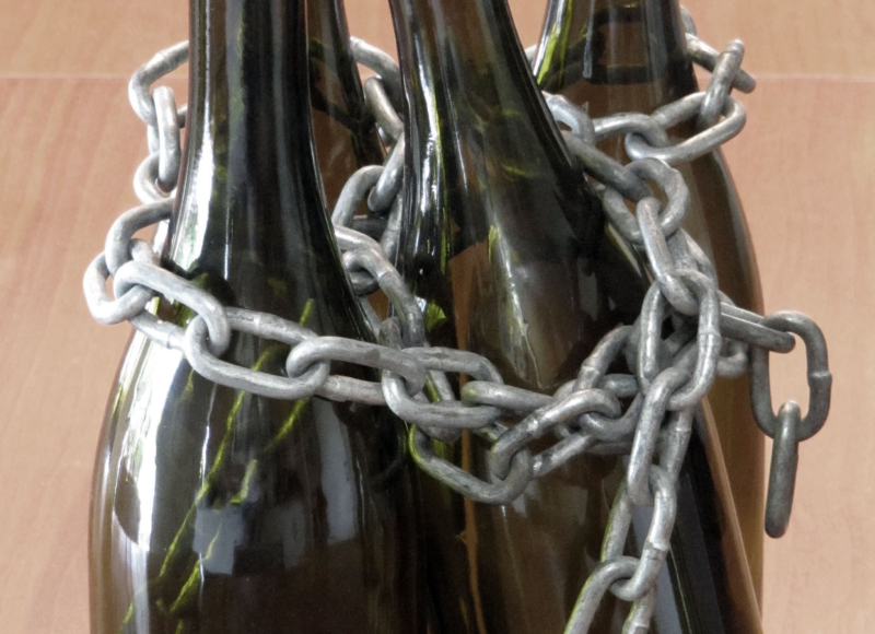 Wine bottles in chains horizontal