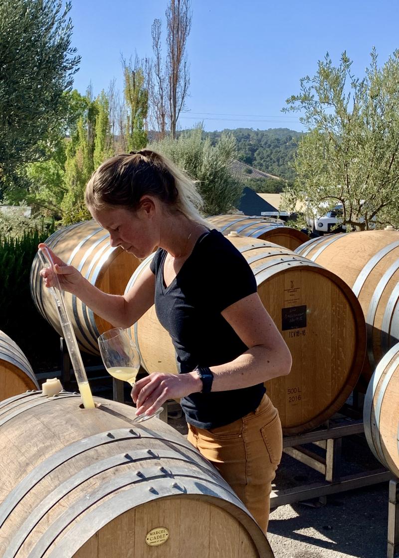 Chelsea tasting Roussanne from barrel vertical