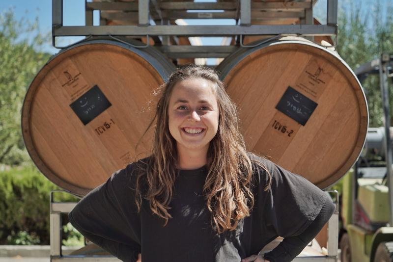 Kayja Mann in front of barrels at Tablas Creek